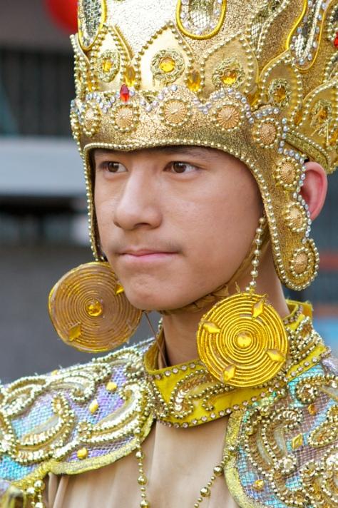 Тайский парень на костюмированном параде. Фото
