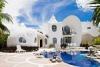 Дом-ракушка на острове Исла-Мухерес, Мексика (24 фото)